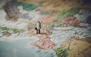 toy man standing on the world map