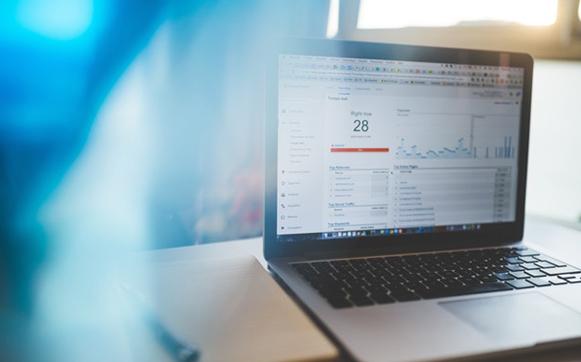 a laptop showing analytics data