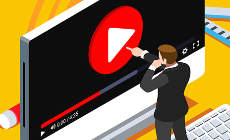 animated person pointing at a human size screen showing a play button